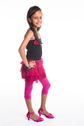A young Indian girl dressed in pink from head to toes.