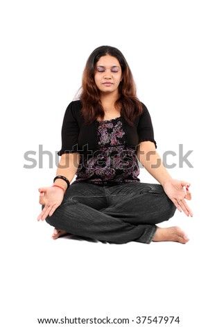 young Indian teenage girl in meditation, on white background ...