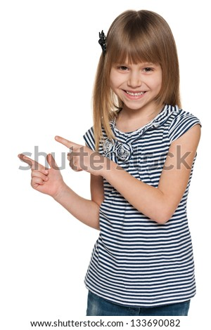 A young laughing girl shows her fingers to the side