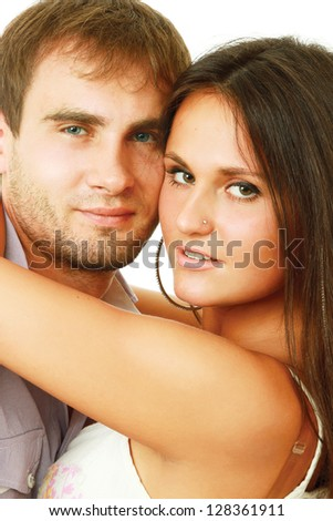 A young loving couple, isolated on white background