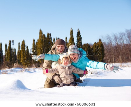 A young loving family enjoying vacation in snow