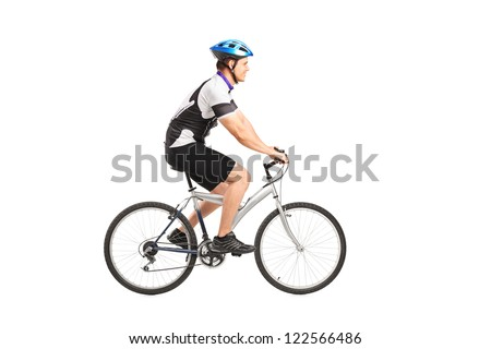 A young male bicyclist riding a bicycle isolated against white background