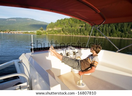 A young male enjoying a luxury boat