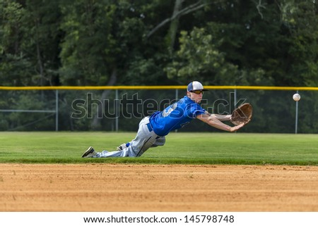 A young male plays baseball on a summer day Stock photo ©