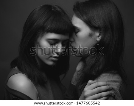 A young man and a young woman kissing. Black and white #1477605542