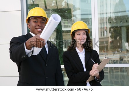 A young man and woman working as  architects on a construction site
