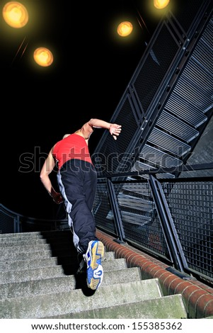 A young man at parkour training in the city