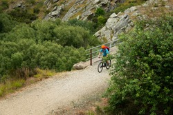 A young man cycling the Otago Central Rail Trail on the Poolburn Viaduct, South Island, New Zealand