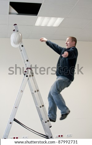 a young man falls from ladder