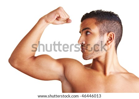 A young man flexing his biceps muscles