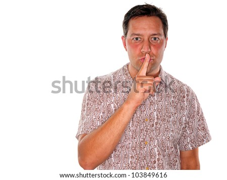 A young man gesturing to keep something confidential