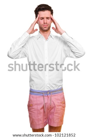 A young man grasping his head where the pain is - a killer headache or migraine. isolated on a white background.