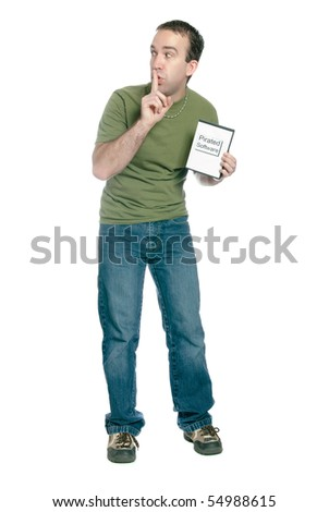 A young man holding a dvd case with pirated computer software in it and telling someone to shhh, isolated against a white background. - stock photo