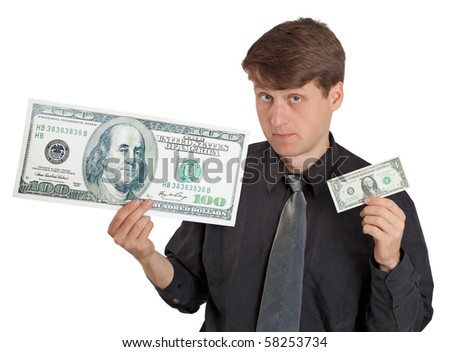 A young man holding a large and small money on white