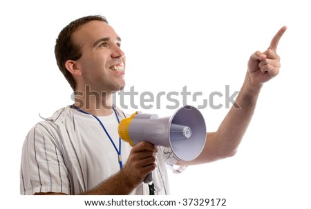A young man holding a megaphone and pointing at white copyspace