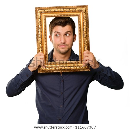 A Young Man Holding And Looking Through Frame On White Background