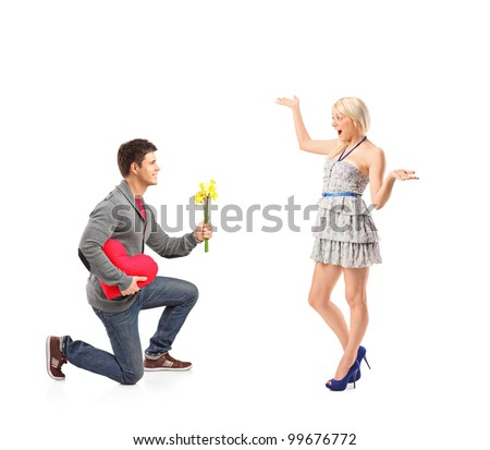 A young man holding bunch of flowers and his excited girlfriend isolated on white background