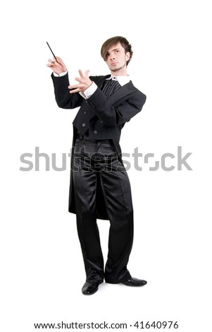 A young man in a black tailcoat with a stick is looking up, isolated