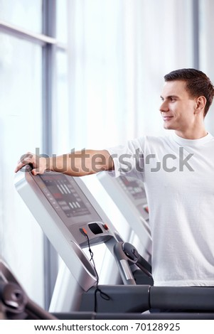 A young man in a fitness club