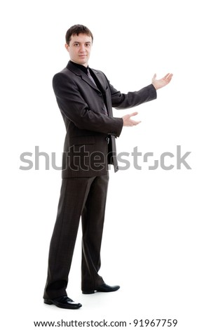 A young man in a suit gestures with his hands, isolated on a white background.