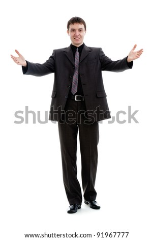 A young man in a suit, welcomes, isolated on a white background.