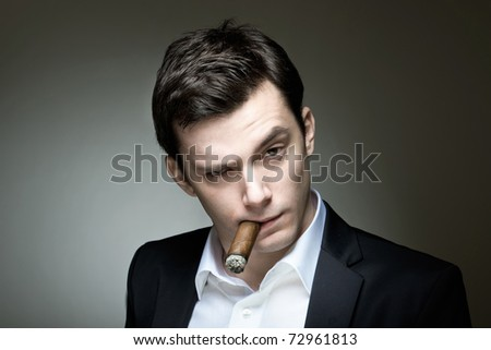 A young man in a suit with a cigar expressing doubt or skepticism