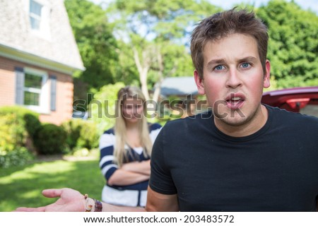 A young man in an argument with his wife, looks to the camera audience for support