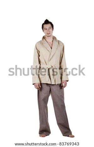 A young man in his pajamas on a white background