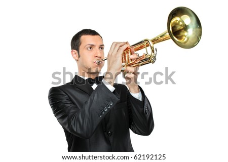 A young man in suit playing a trumpet isolated on white background
