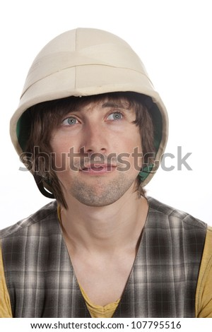A young man in the large cork helmet on a white background in the studio
