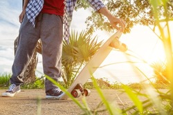 A young man is happily skating down a country road alone to practice his skating skills and have a fun break. Skate surfing skills practice ideas in your spare time to prepare for competitions.