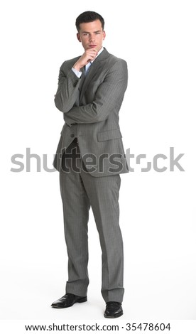 A young man is wearing a business suit and looking at the camera.  Vertically framed shot.