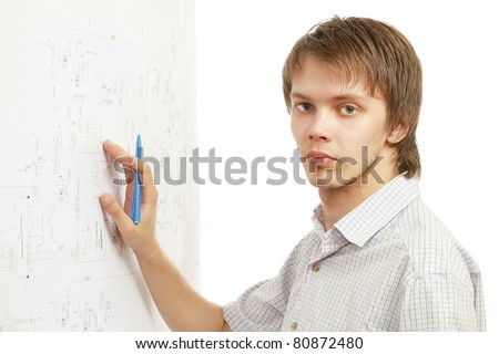 A young man is working with drawings on the wall