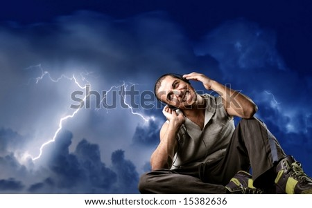 a young man listen music and a storm