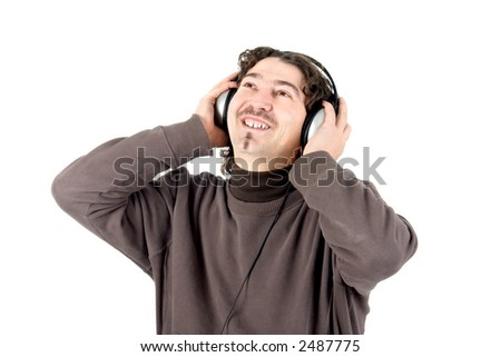 A young man listening to music on large retro headphones
