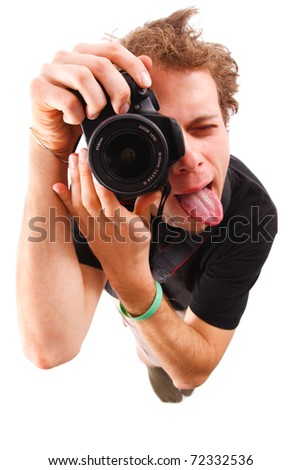 A young man photographing, making funny face.
