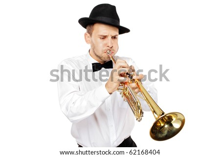 A young man playing a trumpet isolated on white background