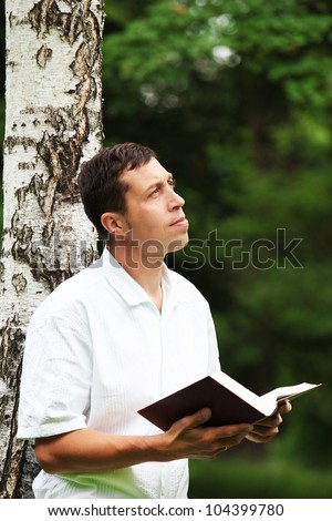A young man reads the Bible