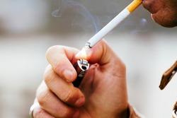 a young man smoking a cigarette