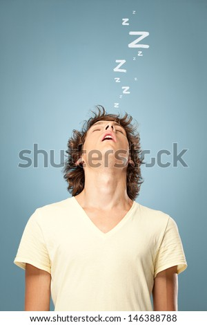 A young man sound asleep while standing. - stock photo