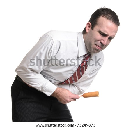 A young man suffering from a stomach ache due to eating a bad corn dog. Isolated against a white background.