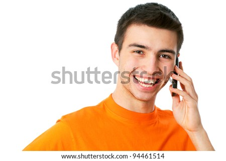 A young man talking on the phone - stock photo