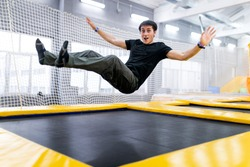 A young man trampolining in fly park