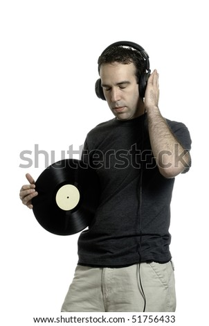 A young man wearing a set of headphones and holding an old LP record, isolated against a white background