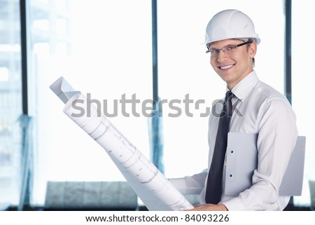 A young man with a project on building