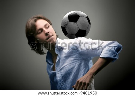 a young man with a soccer ball