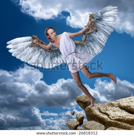 A young man with wings on a background of blue sky.