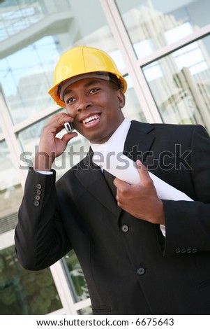 A young man working as an architect on a building site