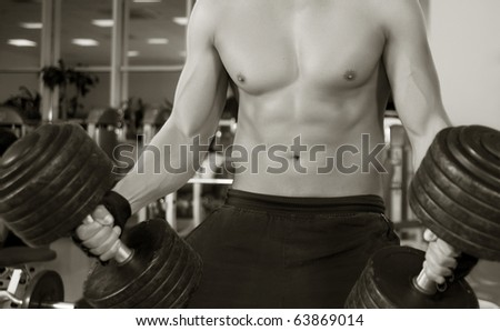 A young man working out in a gym