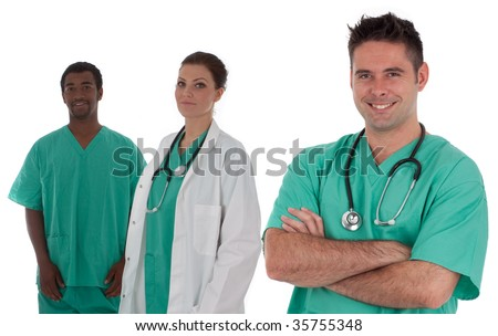 A young medical team is smiling isolated over a white background